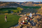Bob Sorensen, a golf course assistant superintendent at The Golf Club at Redlands Mesa in Grand Junction, Colorado stands on the green with his typical day's worth of food in the foreground. (Bob Sorensen is featured in the book What I Eat: Around the World in 80 Diets.) He played football at Mesa State College in Grand Junction and graduated with a degree in criminal justice. Just before he took a desk job in his chosen profession he decided that he didn't want a desk job and found one that requires his constant attendance of the great outdoors, at a golf course at the foot of the majestic Colorado National Monument.  He earned a second degree in turf management, supervises a small crew of greenskeepers, and coaches high school football at Palisade High School. MODEL RELEASED.