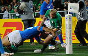 Keith Earls of Ireland gets tackled into touch by Italy's Andrea Masi, during  Ireland v Itlay at Otago Stadium in Dunedin, New Zealand. IRB Rugby World Cup 2011. Sunday 2 October 2011. New Zealand. Photo: Richard Hoodphotosport.co.nz