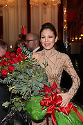 """NEW YORK - JANUARY 19:  Pianist Lola Astanova poses with flowers after performing """"A Tribute to Horowitz"""" presented by the American Cancer Society at the Russian Tea Room on January 19, 2012 in New York City.  (Photo by Matthew Peyton/Getty Images) *** Local Caption *** Lola Astanova"""