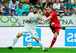Bojan Jokic of Slovenia vs Phil Jones of England during the EURO 2016 Qualifier Group E match between Slovenia and England at SRC Stozice on June 14, 2015 in Ljubljana, Slovenia. Photo by Vid Ponikvar / Sportida