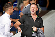 Peterborough United owner Darragh MacAnthony shares a joke before the Pre-Season Friendly match between Peterborough United and Bolton Wanderers at London Road, Peterborough, England on 28 July 2018. Picture by Nigel Cole.