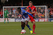 York City defender Dave Winfield battles it out with Carlisle United forward Jabo Ilbehre during the Sky Bet League 2 match between York City and Carlisle United at Bootham Crescent, York, England on 19 September 2015. Photo by Simon Davies.