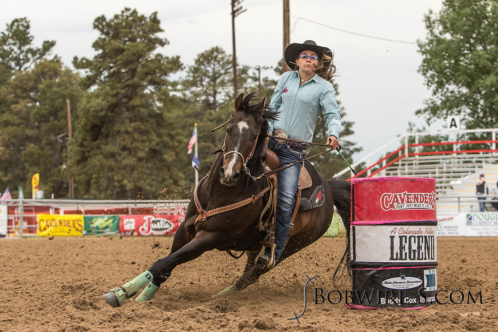 Rachel Sorenson makes her barrel racing run during slack at the Elizabeth Stampede on Sunday, June 3, 2018.