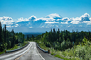 Mount Sanford (16,237 ft), the sixth highest mountain in the United States, a strato-volcano (or composite cone), rises prominently in the Wrangell Mountains, seen from the Glenn Highway, Alaska. The Wrangell Lavas built the Wrangell Mountains over the past 10 million years.