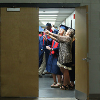Nettleton seniors get one last selfie in the dressing area before their graduation ceremony begins Saturday morning.