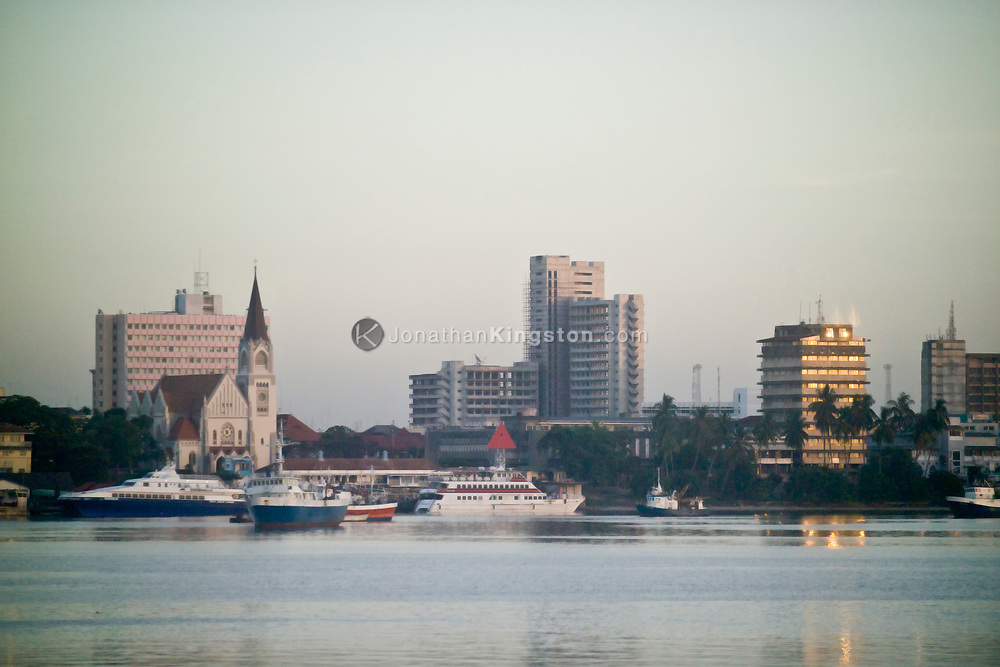 A early morning sunrise view of the harbor and downtown Dar es Salaam, Tanzania.
