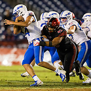 12 October 2018: San Diego State Aztecs defensive lineman Anthony Luke (45) tries to wrap up Air Force Falcons quarterback Isaiah Sanders (4) in the back field on a quarterback keeper in the fourth quarter. The Aztecs beat the Falcons 21-17 Friday night at SDCCU Stadium.