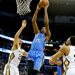 Dec 2, 2014; New Orleans, LA, USA; Oklahoma City Thunder forward Kevin Durant (35) dunks between New Orleans Pelicans forward Anthony Davis (23) and forward Ryan Anderson (33) during the second half of a game at the Smoothie King Center. The Pelicans defeated the Thunder 112-104. Mandatory Credit: Derick E. Hingle-USA TODAY Sports