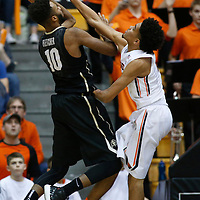 Colorado's Tre'Shaun Fletcher, left, gets his shot blocked by Oregon State's Stephen Thompson Jr. in the second half of an NCAA college basketball game in Corvallis, Ore., on Saturday, Feb. 6, 2016. Oregon State won 60-56. (AP Photo/Timothy J. Gonzalez)
