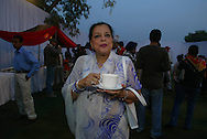 "An Indian woman wearing a traditional Indian Sari sips her tea at the end cocktail party for the Pizza hut Polo tournament at the Jaipur Polo Ground in New Delhi, India Sunday Nov. 3, 2002. ""The chiffon and pearl brigade, we call it,"" said Asmita Agarwal, a tough-talking polo and fashion writer for the Hindustan Times. ""Women in chiffon saris dripping with huge diamonds ... They're all royalty, or at least they're trying to be royalty.""  In many ways, that's what modern Indian polo is about joining the new royalty."