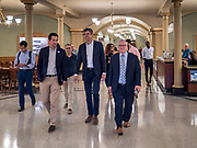 22 AUGUST 2019 - DES MOINES, IOWA: BETO O'ROURKE (D-TX), center, walks through the Iowa State Capitol on his way to a gun safety roundtable. O'Rourke hosted the gun safety roundtable in the Iowa State Capitol in Des Moines. He is back on the campaign trail seeking the Democratic nomination for the US Presidency after pausing his campaign when a white supremacist massacred 22 people in El Paso, TX, O'Rourke's hometown. Iowa traditionally hosts the first selection event of the presidential election cycle. The Iowa Caucuses are Feb. 3, 2020.       PHOTO BY JACK KURTZ