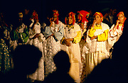 Traditional ladies singing and dancing