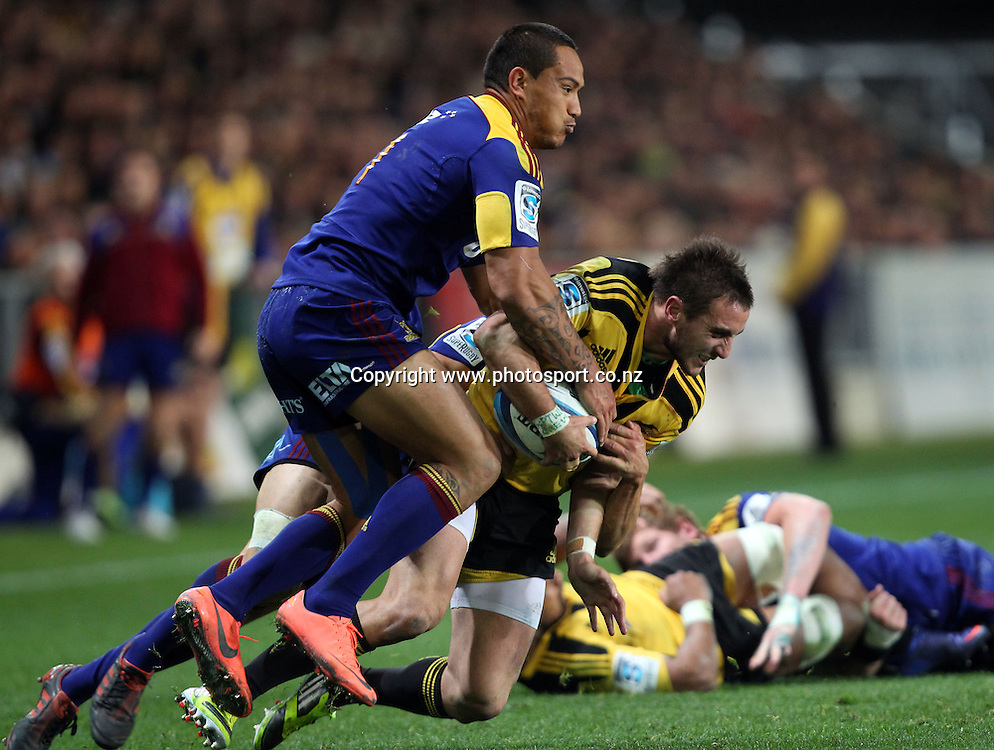 Andre Taylor is hit hard by Hosea Gear.<br /> Investec Super Rugby - Highlanders v Hurricanes, 12 May 2012, Forsyth Barr Stadium, Dunedin, New Zealand.<br /> Photo: Rob Jefferies / photosport.co.nz