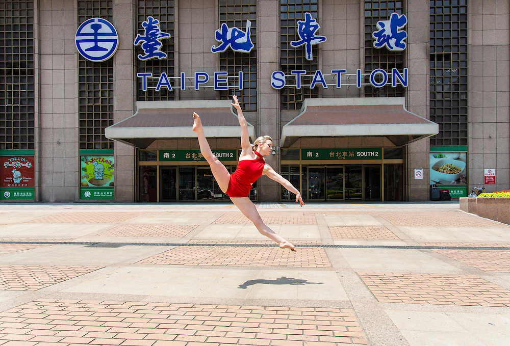 A ballerina leaps outside Taipei Station.