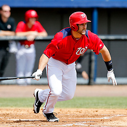Mar 9, 2013; Melbourne, FL, USA; Washington Nationals second baseman Stephen Lombardozzi (1) hits a two run single scoring Ryan Zimmerman and Danny Espinosa during the bottom of the second inning of a spring training game against the Miami Marlins at Space Coast Stadium. Mandatory Credit: Derick E. Hingle-USA TODAY Sports