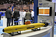 © Rob Arnold 11/03/2014. London, UK. The Teledyne Gavia Offshore Surveyor Autonomous Underwater Vehicle (AUV). Oceanology International (OI), the world's largest exhibition for marine science and technology, gets underway at London's ExCeL Centre. The three day exhibition provides an opportunity for industry, academic and government organisations to share knowledge and promote improvements in technology and strategy used for operating, surveying, protecting and exploiting resources in the oceans of the world. Photo Credit : Rob Arnold