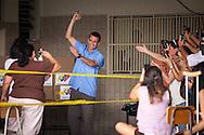El candidato opositor, Henrique Capriles Radonski sonrie luego de ejercer su derecho al voto junto a sus simpatizantes durante las elecciones regionales realizadas en Caracas. 16 Dic. 2012. (Foto/ivan gonzalez)