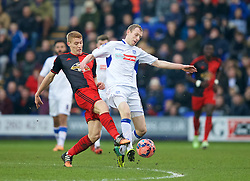 BIRKENHEAD, ENGLAND - Saturday, January 3, 2015: Tranmere Rovers' Marc Laird in action against Swansea City's Jay Fulton during the FA Cup 3rd Round match at Prenton Park. (Pic by David Rawcliffe/Propaganda)