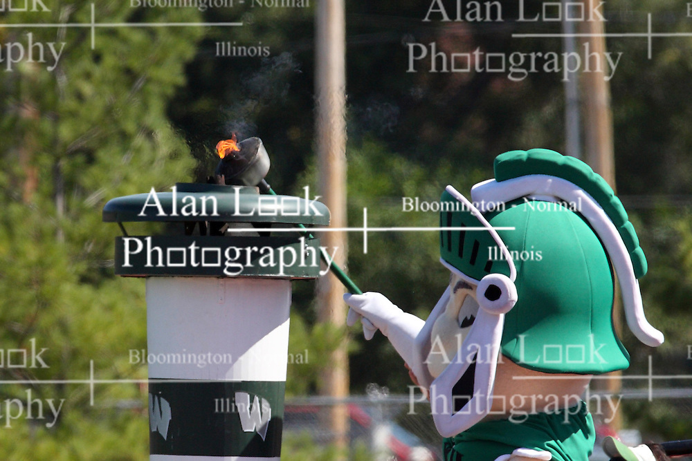 17 September 2011: Mascot Tommy Titan lights the victory tourch before the during an NCAA Division 3 football game between the Aurora Spartans and the Illinois Wesleyan Titans on Wilder Field inside Tucci Stadium in.Bloomington Illinois.