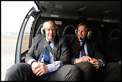 Tom Bradby ITV Political Editor. with The Mayor of London Boris Johnson in a helicopter flying into Hong Kong, China. Friday 18th October 2013. Picture by Andrew Parsons / i-Images