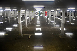 © Licensed to London News Pictures. 21/12/2019. Guildford, UK. Flood water in a partially submerged car park reflects ceiling lights in Guildford, Surrey River levels remain high after heavy overnight rain in the south where more rain is expected today. Photo credit: Peter Macdiarmid/LNP