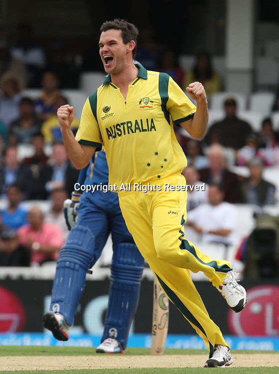 17.06.2013 London, England. Clint McKay of Australia celebrates the catch of Kumar Sangakkara of Sri Lanka during the ICC Champions Trophy Group A fixture between Australia and Sri Lanka from The Oval.