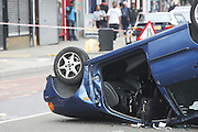 24.JUNE.2011. LONDON<br /> <br /> CAR CRASH IN BRIXTON LEAVING A CAR UPSIDE DOWN IN THE MIDDLE OF THE ROAD<br /> <br /> BYLINE: EDBIMAGEARCHIVE.COM<br /> <br /> *THIS IMAGE IS STRICTLY FOR UK NEWSPAPERS AND MAGAZINES ONLY*<br /> *FOR WORLD WIDE SALES AND WEB USE PLEASE CONTACT EDBIMAGEARCHIVE - 0208 954 5968*