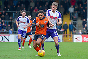 Scunthorpe United midfielder Duane Holmes (19) battles with Rotherham United Defender Will Vaulks (4) during the EFL Sky Bet League 1 match between Scunthorpe United and Rotherham United at Glanford Park, Scunthorpe, England on 10 February 2018. Picture by Craig Zadoroznyj.