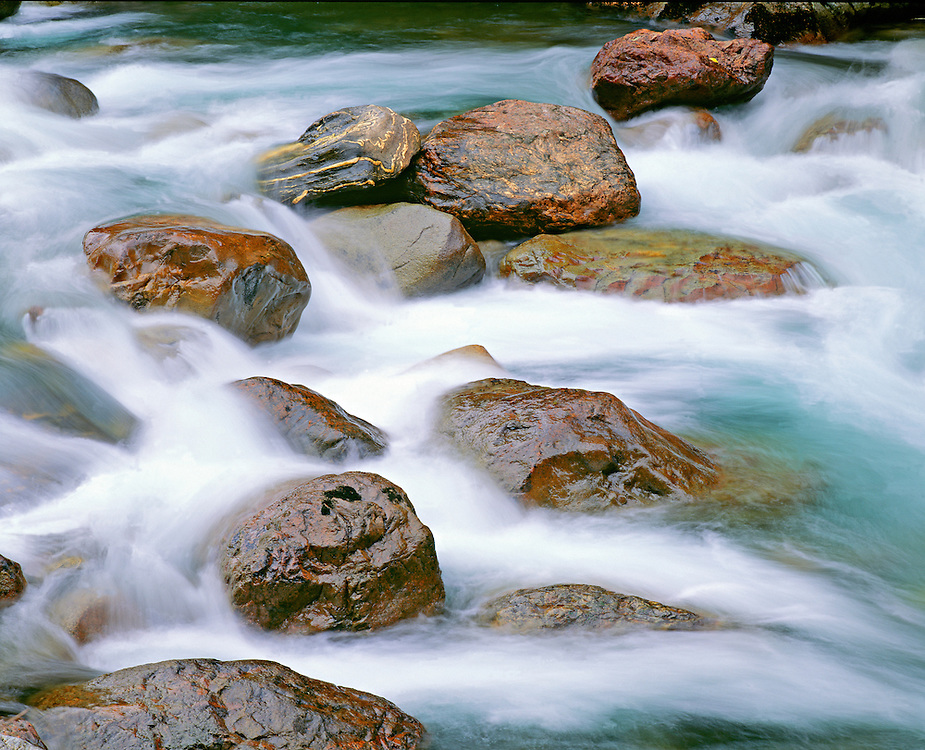 Large Red Boulders and Rushing Spring Runoff in Sauk River, Washington State