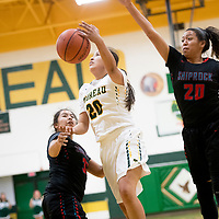 Thoreau Hawk Shavonne Livingston (20), center, drives between Shiprock Chieftains Lisa Begay (33), left, and Aiona Johnson (20) at Thoreau High School Friday.