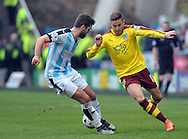 Joe Lolly of Huddersfield Town challanges Michael Kightly of Burnley during the Sky Bet Championship match at the John Smiths Stadium, Huddersfield<br /> Picture by Graham Crowther/Focus Images Ltd +44 7763 140036<br /> 12/03/2016