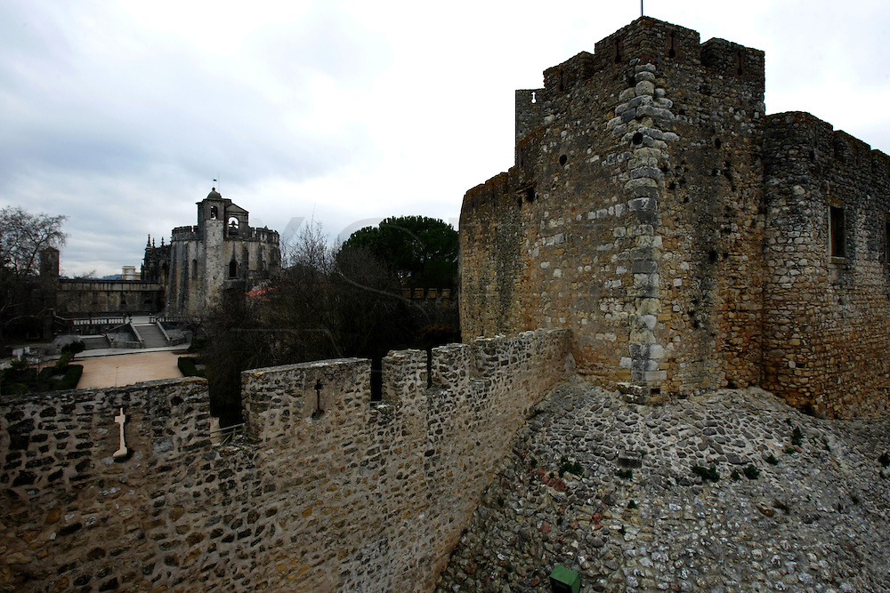 An outside view of the castle (right) , and the Convent of Jesus Christ at Tomar in the Center of Portugal. Built in the 12 th Century by the Poor Knights of Jesus Christ (the Templars), with strong influence from Jerusalem's religious buildings from the time of Crusades, as the Temple of the Rock.Paulo Cunha/4see