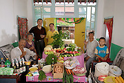 (MODEL RELEASED IMAGE).The Cui family of Weitaiwu village, Beijing Province, in their living room with a week's worth of food. Cui Haiwang, 33, and Li Jinxian, 31, stand with their son, Cui Yuqi, 6, Haiwang's mother, Wu Xianglian, 61, and father, Cui Lianyou, 59, and Haiwang's grandmother, Cui Wu, 79. The Cui family is one of the thirty families featured in the book Hungry Planet: What the World Eats (p. 82).
