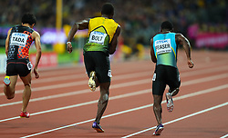 London, 2017-August-04. Usain Bolt powers away at the start of the men's 100m heat at the IAAF World Championships London 2017. Paul Davey.