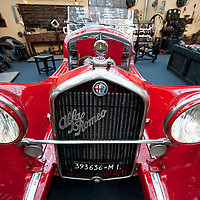 MILAN, ITALY - JUNE 23: An 1931 Alfa Romeo GC 1750 Grand Sport is displayed in a reproducted traditional garage at an Alfa Romeo exhibition on June 23, 2010 in Milan, Italy. Italian car manufacturer Alfa Romeo celebrates its 100th anniversary as the original company A.L.F.A was founded in Milan on June 24, 1910...***Agreed Fee's Apply To All Image Use***.Marco Secchi /Xianpix. tel +44 (0) 207 1939846. e-mail ms@msecchi.com .www.marcosecchi.com