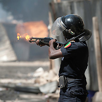 "A policeman shoot gas on February 19, 2012 during clashes that erupted outside a mosque in Dakar, which demonstrators said had been ""profaned"" when it was hit by tear gas grenades thrown by a police officer on February 17. Senegalese riot police fired volleys of tear gas and rubber bullets at stone-throwing demonstrators after prayers at a mosque in the Senegalese capital on February 19.  ©Sylvain Cherkaoui"