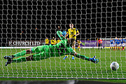 Alex Bass (35) of Portsmouth dive the right way during the penalty shoot out at full time but the fails to make the save during the Leasing.com EFL Trophy match between Oxford United and Portsmouth at the Kassam Stadium, Oxford, England on 8 October 2019.