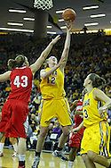 January 08 2010: Iowa center Morgan Johnson (12) puts up a shot as Ohio St. forward Sarah Schulze (43) defends during the first half of an NCAA womens college basketball game at Carver-Hawkeye Arena in Iowa City, Iowa on January 08, 2010. Iowa defeated Ohio State 89-76.