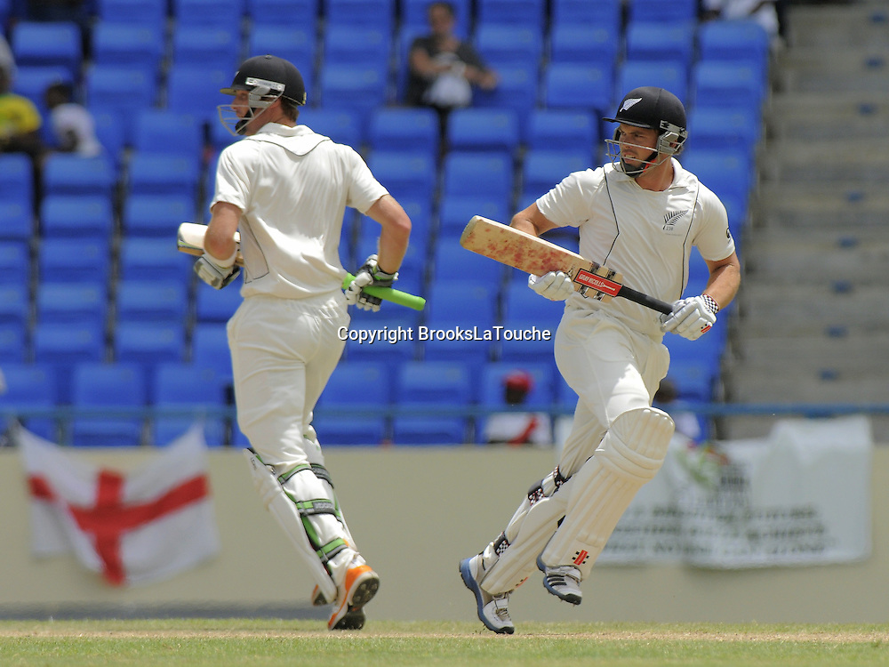 Martin Guptill and Daniel Flynn, Day one of the first test West Indies v New Zealand at Sir Vivian Richards Stadium, Antigua. 25 July 2012. Photo: Randy Brooks/photosport.co.nz