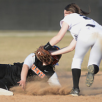 Laura Stoecker/lstoecker@dailyherald.com<br /> St. Charles East's Delany Devor is tagged out (in the face) at second base by Kaneland's Morgan Weber in the fifth inning Wednesday.