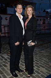 Johnnie Walker Gold Label Reserve Finale Celebration Party aboard the John Walker & Sons Voyager moored at the Prince of Wales Docks, Leith, Edinburgh, Scotland on 14th August 2013.<br /> Picture shows:-Mark Hailey and Phoebe Grigor.