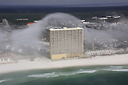 Spectacular 'cloud tsunami' rolls over Florida high-rise condos<br /> <br /> Breathtaking images of 'wave clouds' were captured by a helicopter pilot as they rolled off the sea and inland, completely engulfing a beachfront city. <br /> The surreal event was captured by helicopter pilot Mike Schaeffer who was just finishing a tour of the coastline in Panama City Beach, Florida when he spotted the weather phenomenon - called a Kelvin–Helmholtz instability.<br /> The cloud swept across the sands creating a tsunami effect and over the top of the roofs of the beachfront blocks of condos earlier this month<br /> It normally occurs in regions with vast plains where winds quickly change speed creating turbulence but appeared in the beachfront city on February 5.   <br /> A fast-moving, lighter density cloud slides on top of a slower, thicker layer, dragging out the surface and creating the wave effect.<br /> <br /> The Cloud Appreciation Society explains the quirky weather phenomenon. They are the result of turbulence in a layer of Cirrus cloud where air currents exist of differing speeds or directions - making the cloud resemble a wave rolling along the top of the water. <br /> The incredibly uncatchy name is a combination from Lord Kelvin - a Scottish baron who along with a German physicist Hermann Helmholtz - came up with an explanation for the freak occurrence. <br /> ©JR Hott / Exclusivepix