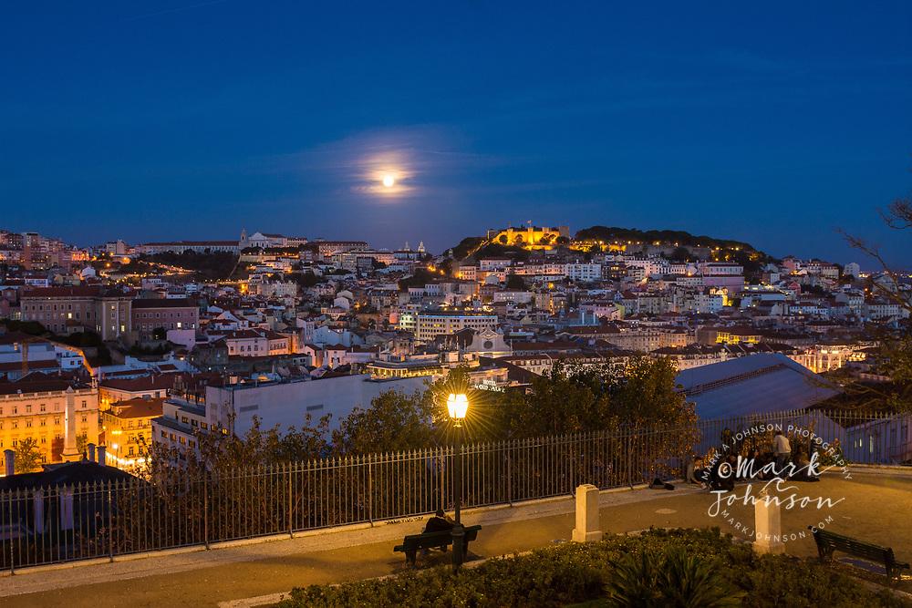 Full moon rising over Lisbon Portugal from the Miradouro de Sao Pedro de Alcantara