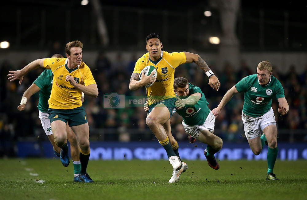 Australia's Israel Folau is tackled by Ireland's Garry Ringrose during the Autumn International match at the Aviva Stadium, Dublin.
