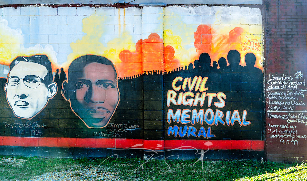 """A mural featuring Rev. James Reeb and Jimmie Lee Jackson is painted on a building at Civil Rights Memorial Park, Feb. 7, 2015, in Selma, Alabama. The park was established in 2001 and includes murals and plaques honoring those who led the Civil Rights movement in Selma in the 1960's. Reeb, a Unitarian Universalist minister from Boston, killed in Selma in 1965 due to his work with the Civil Rights movement.  Jackson, a Baptist church deacon, was also killed in 1965 in Selma due to his participation in the Civil Rights movement. The mural was part of the """"Liberation Summer Project"""" in 1999. (Photo by Carmen K. Sisson/Cloudybright)"""