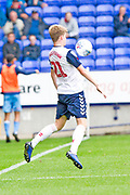Bolton Wanderers defender Harry Brockbank chest the ball down during the EFL Sky Bet League 1 match between Bolton Wanderers and Coventry City at the University of  Bolton Stadium, Bolton, England on 10 August 2019.