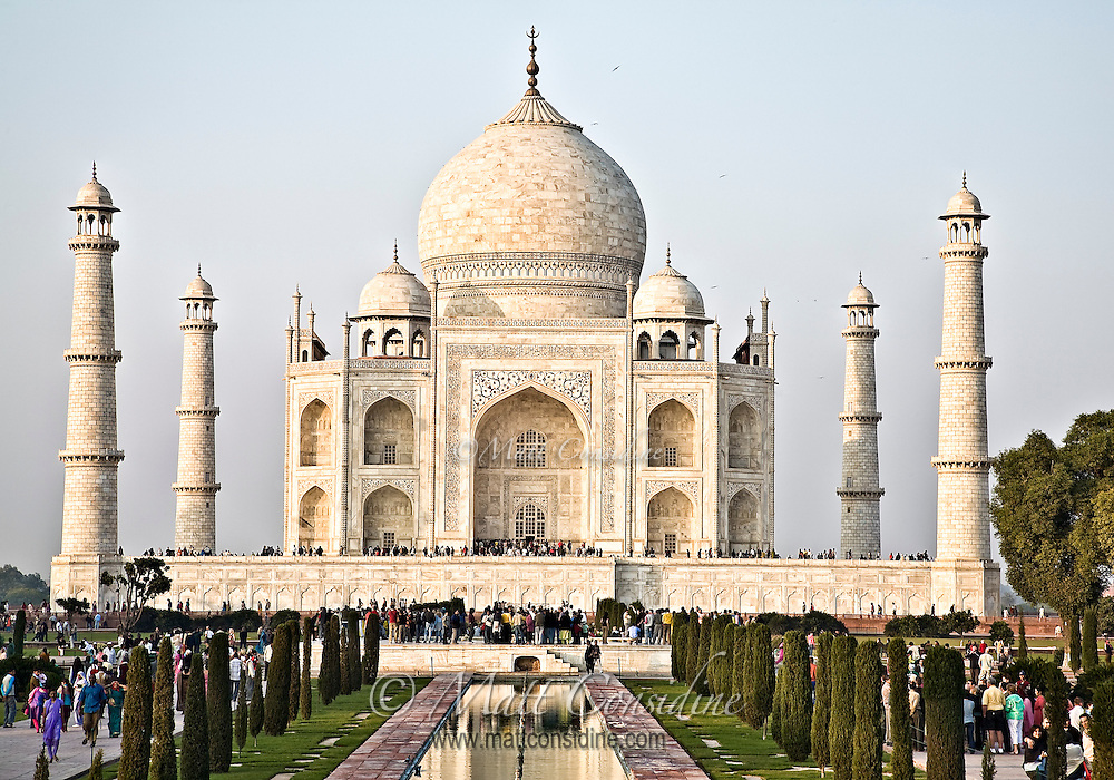 Tourists enjoying the Taj Mahal, built by the Mughal emperor Shah Jahan in the memory of his beloved wife Mumtaz Mahal.