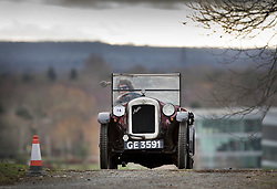 © Licensed to London News Pictures. 28/01/2018. Weybridge, UK. Mrs Fabienne Muschamp crests her 1928 Austin 7 AD at the top of the steep gradient on the hill test at Brooklands Museum during The Vintage Sports-Car Club's New Year driving tests.  Photo credit: Peter Macdiarmid/LNP