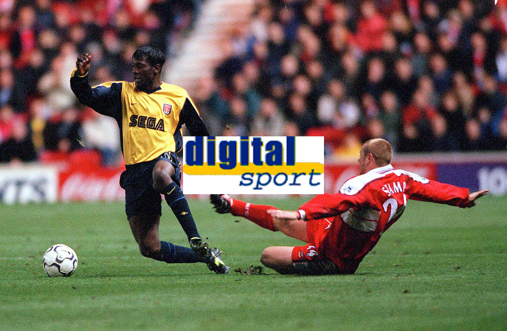 Lauren (Arsenal) fouled by Philip Stamp (Middlesbrough). Middlesbrough 0:1 Arsenal. F.A.Carling Premiership, 4/11/2000. Credit Colorsport / Stuart MacFarlane.