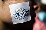A high school student wears a sticker in support of stronger gun regulation during the walkout and march on the State Capitol  Madison, Wisconsin, Wednesday, March 14, 2018.